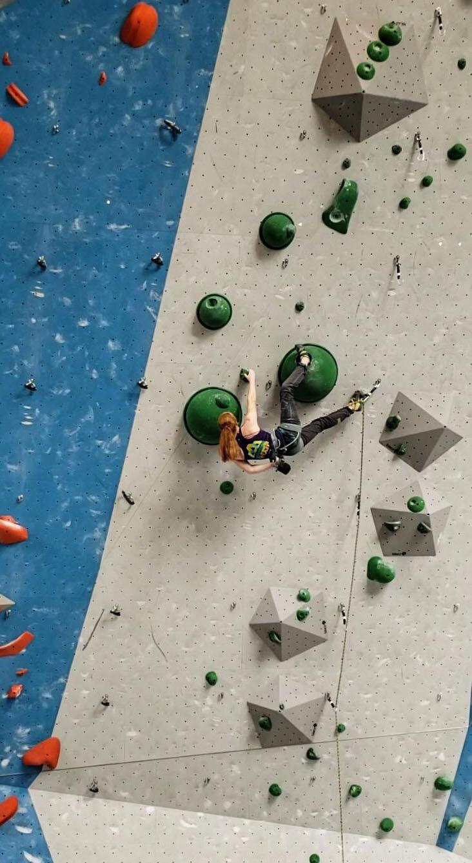 Aubrey climbing at Divisionals.