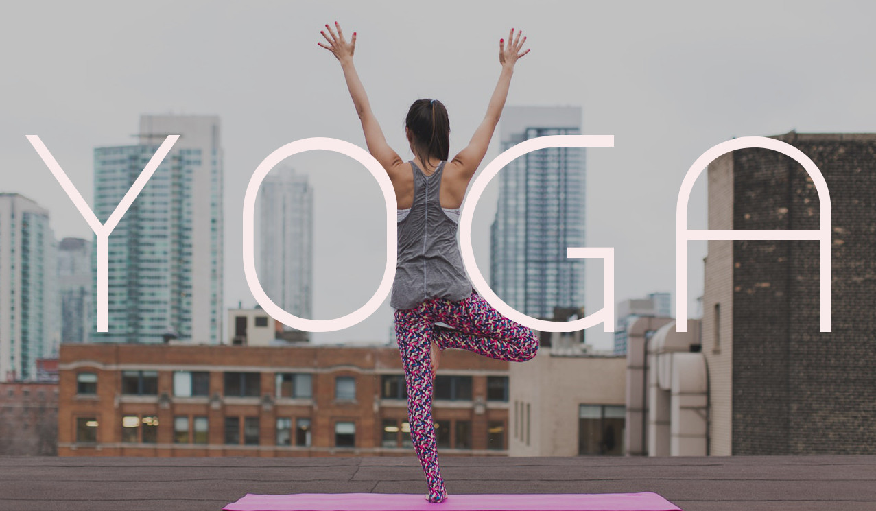 Yoga Club - picture of a lady holding a yoga pose on a city skyline view