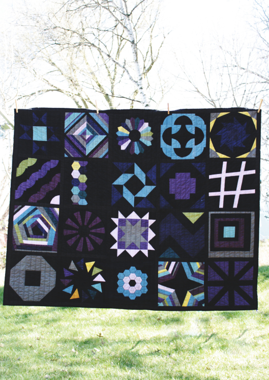black and color block of the month quilt