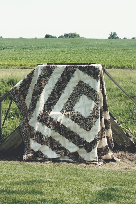 barn-raising-quilt-on-steps-e1406286964715.jpg