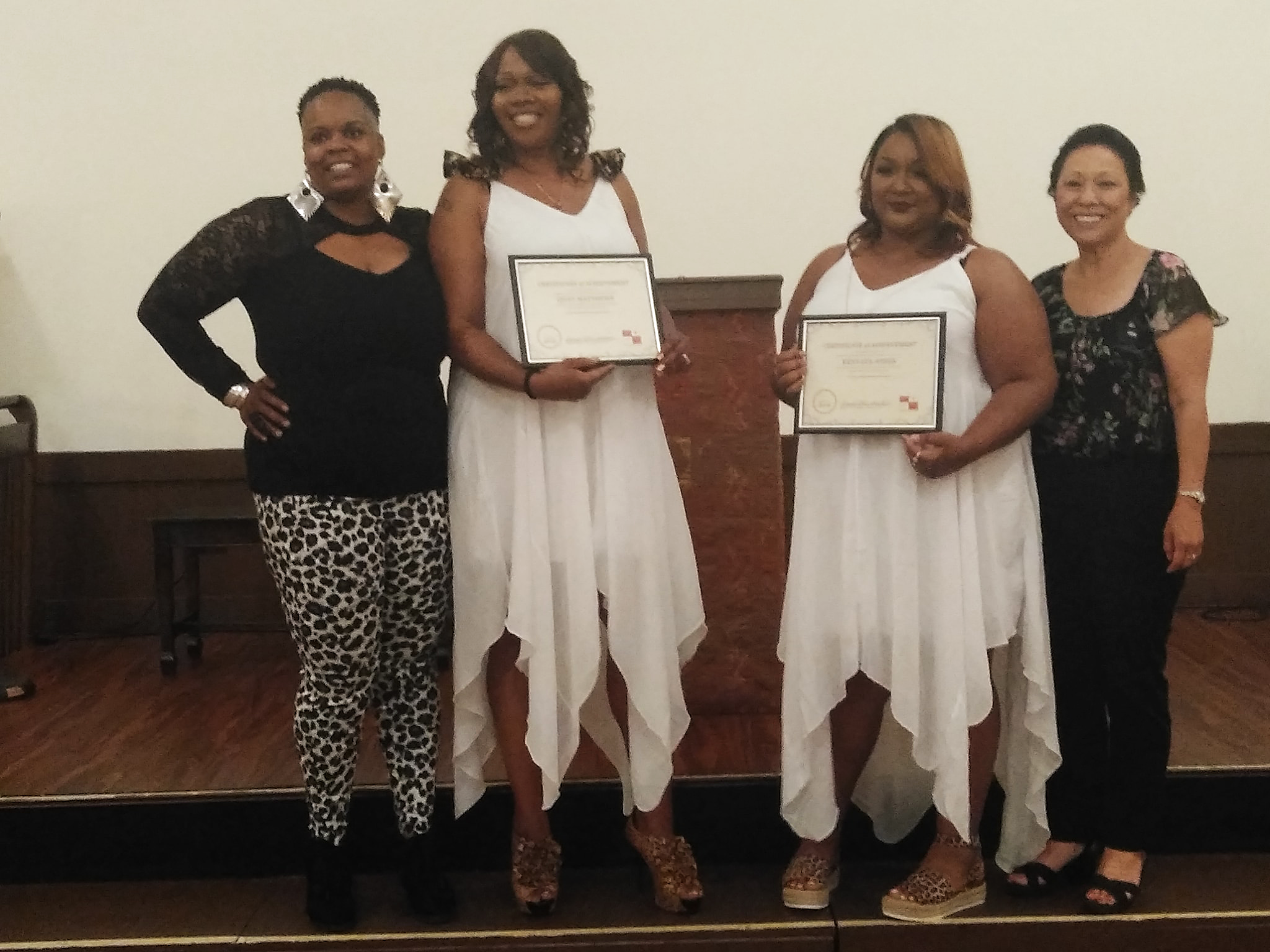 "Founder & President Shannon Olive with Portland Commissioner Lori Stegmann and the two July graduates of the ""I Love Me"" Women's Empowerment group, Quay Matthews and Kenyata Jones. ."