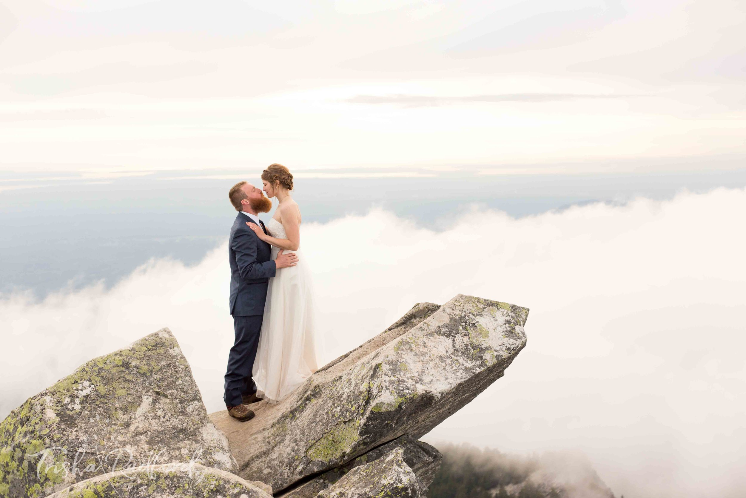 Photo of an adventurous couple who eloped on Mount Pilchuck in Snohomish County.