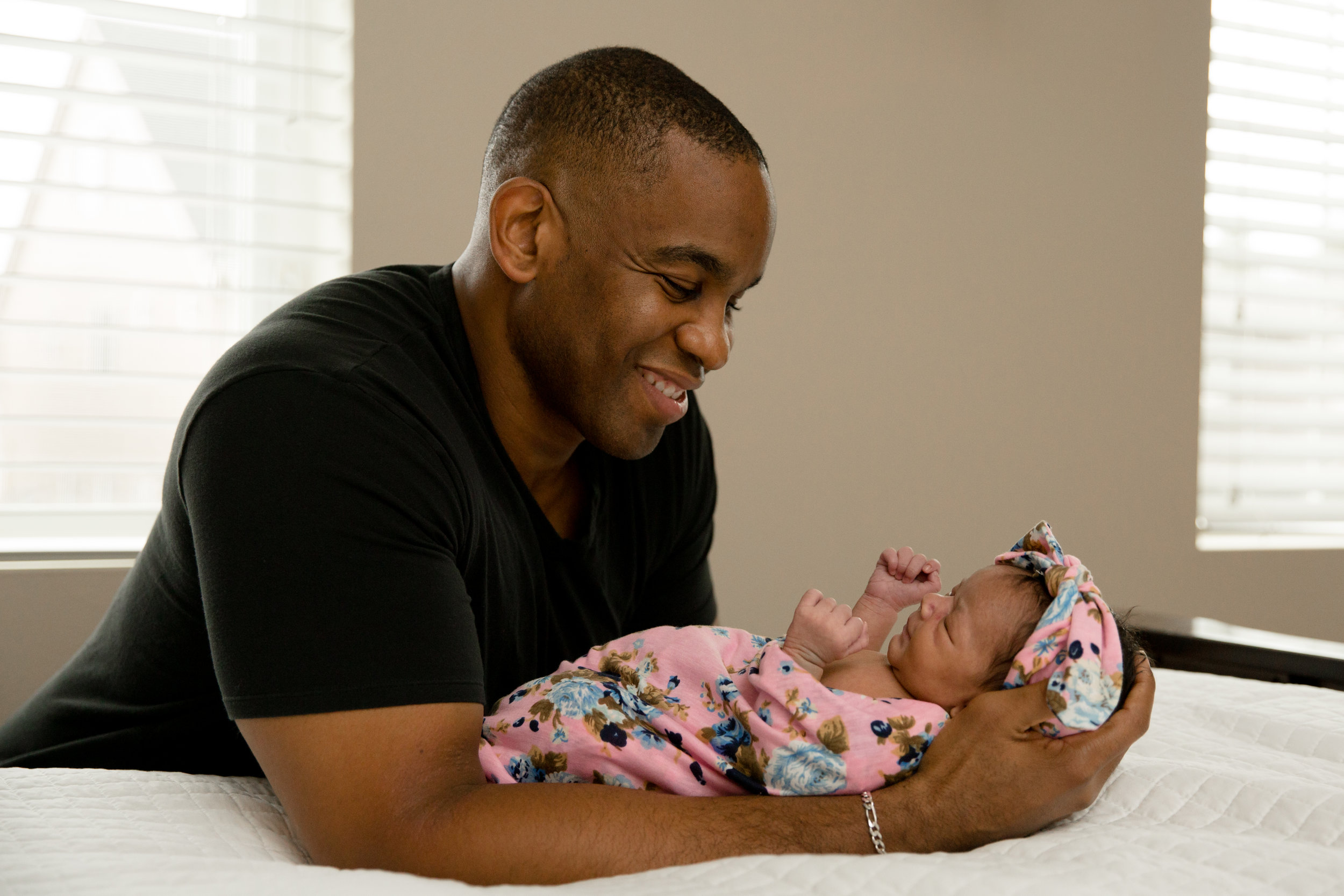 Beautiful baby girl being held by her dad