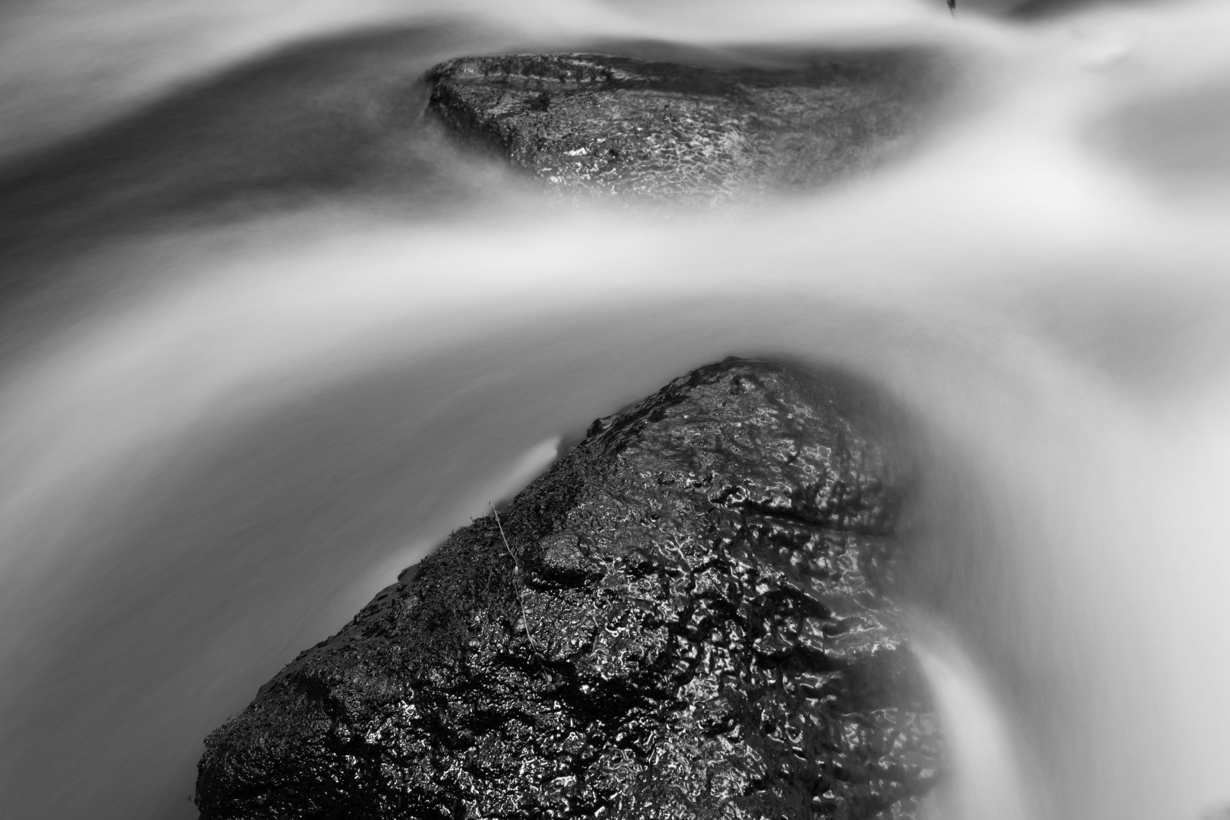water_flowing_two_rocks.jpg