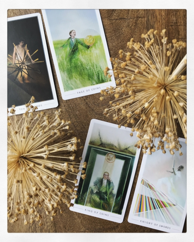 Ten of Wands, Page of Coins, King of Coins, and Knight of Swords from The Fountain Tarot