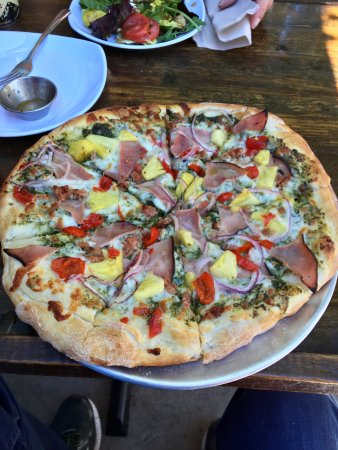 Big Island - pesto base with mozzarella, ham, bacon, pineapple, peppadew peppers, and red onion