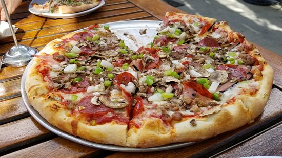 Deluxe (the traditional) - traditional pizza sauce base with mozzarella, pepperoni, sausage, ham, green peppers, onion, and mushroom