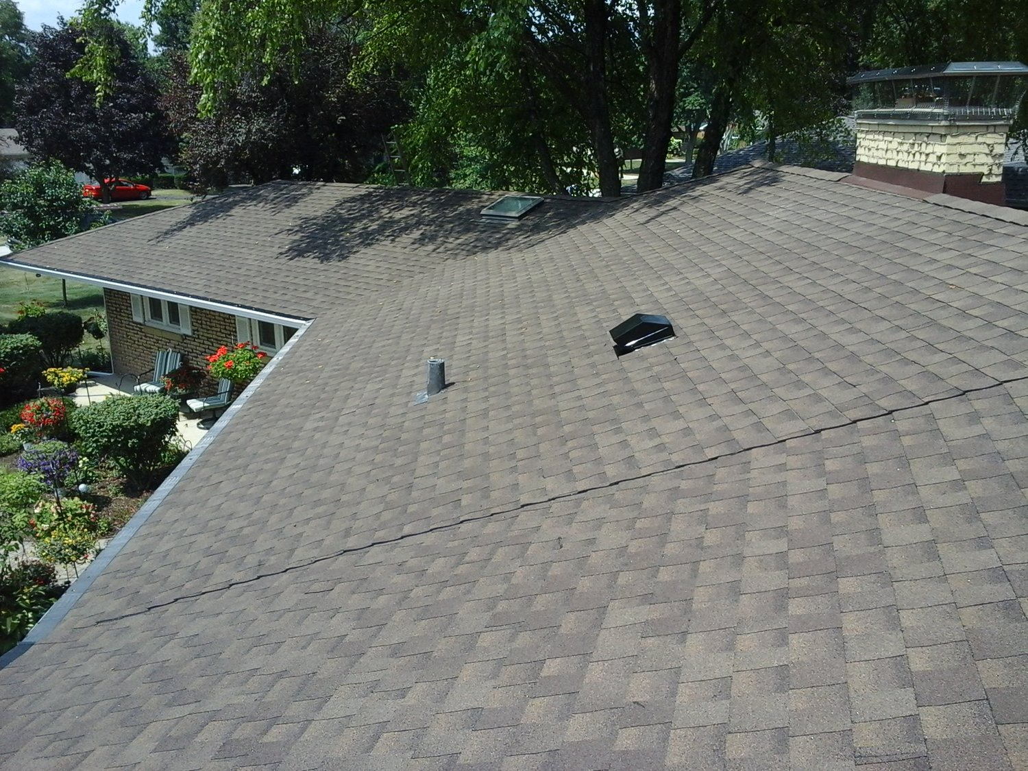 Residential Low Slope Services - Do you have a low slope roof? We have helped thousands of local homeowners with evaluating, installing, maintaining and providing warranties for complete roofing solutions. We're the roofers you can depend on for long term peace of mind through: wind, rain, and snow. For a FREE Estimate - Call: (630) 530-5944