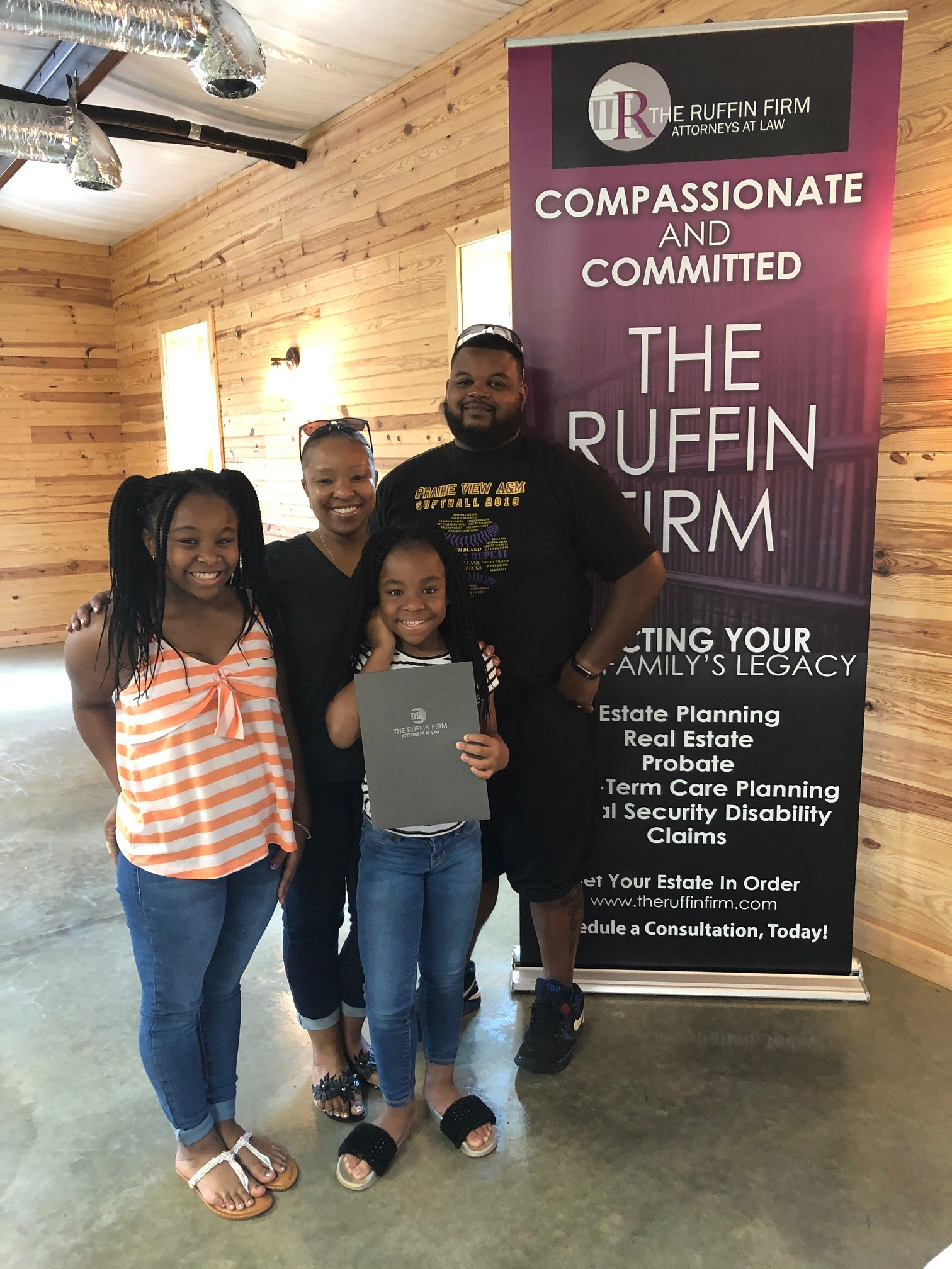 The Smith Family pose for a photo after drafting a will with  The Ruffin Firm  during the Cobbtown, Ga Will Clinic.