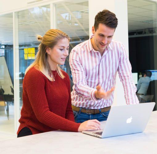 adults-colleagues-desk-1647905 500.jpg