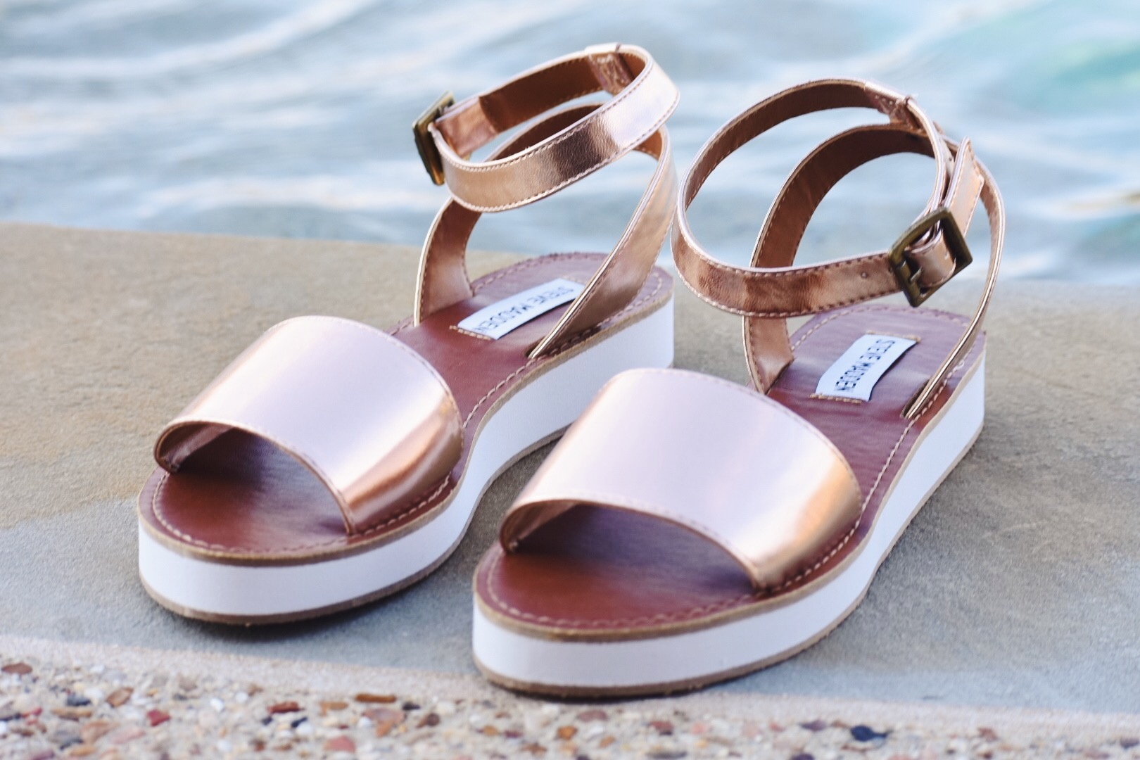 Blush pink is my favorite neutral for spring! - Steve Madden is a fantastic shoe designer. His shoes are always trendy enough for the season, but still classic to last more than one season. His shoes are also comfortable, which in my book, is a must for shoes. I love these sandals because the small platform make them perfect for both dressy and casual occasions. The platinum blush pink also adds some dressiness to the look.
