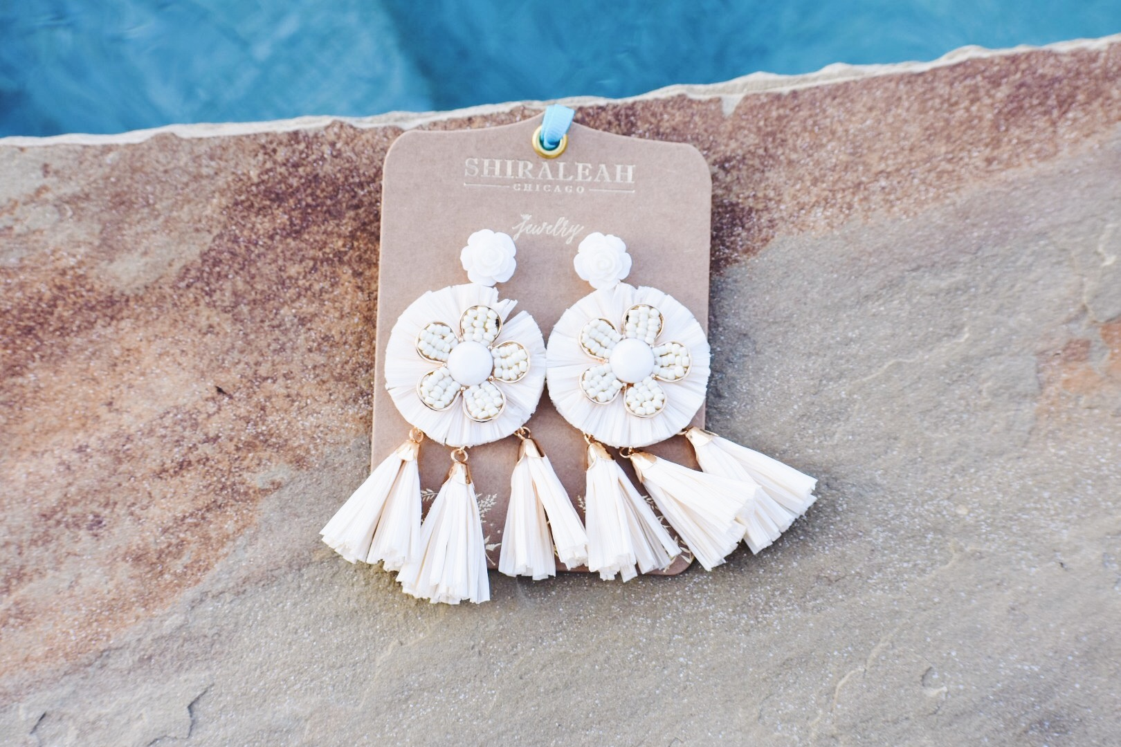 You know me and statement earrings!! These are perfect because they will literally go with everything and they make quite the statement! I got these at Tulip (of course). I love boutiques because you can always find really exclusive stuff. If you're in Norman or the surrounding areas, definitely pay a visit to Tulips for all your spring accessory needs! I'm a big believer of shopping local, so go check them out!