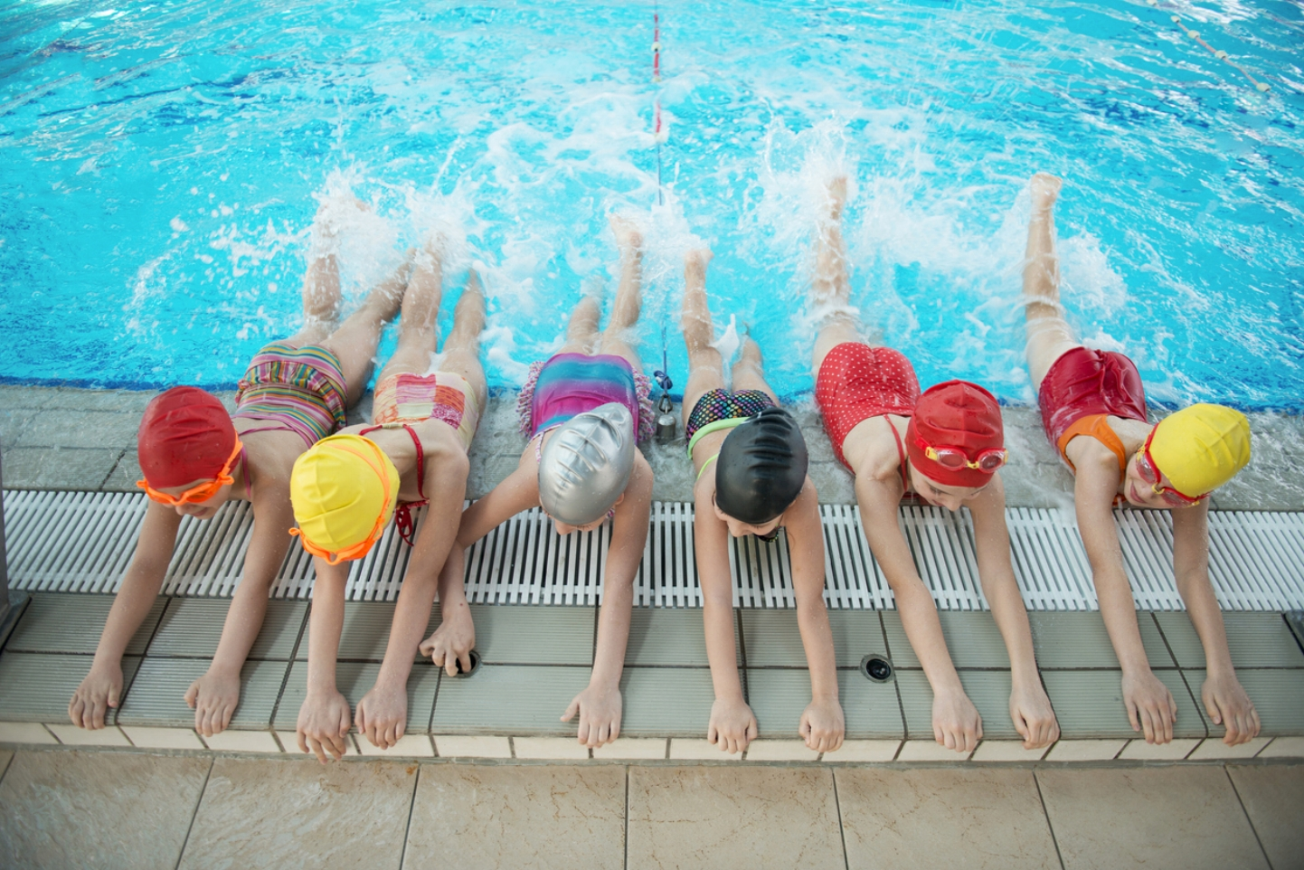 happy-children-kids-group-at-swimming-pool-class-learning-to-swim-669788648_1256x838.jpeg