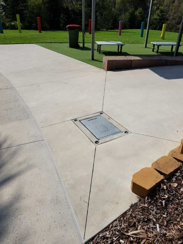Hot metal cover in the middle of a picnic area.
