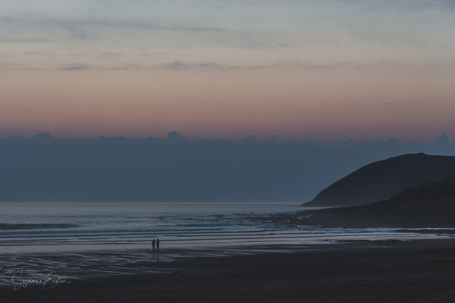 Watching the day end at Croyde Beach.  Two people talking as the sun sets
