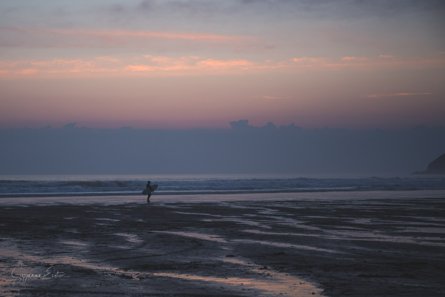 The end of the day at Croyde.  A surfer admiting defeat as he leaves the beach at sunset