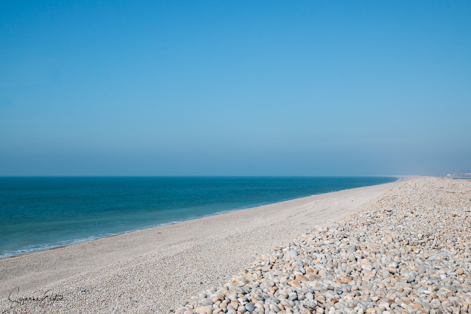 Chesil Beach in Dorset is an 18mile long beach. It is the largest tombolo in England and part of the UNESCO World Heritage Jurassic Coast.