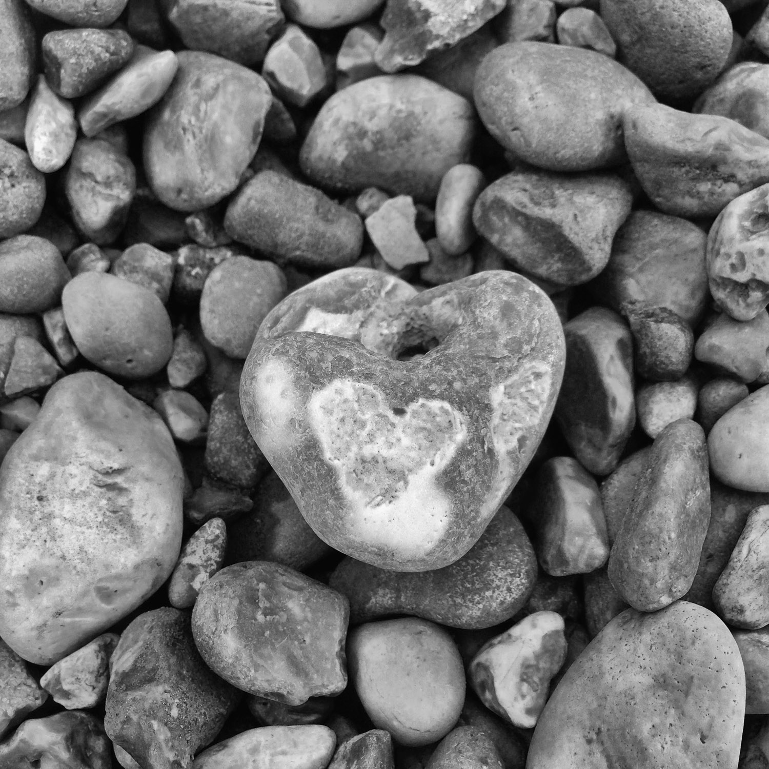 Heart pebble with hole