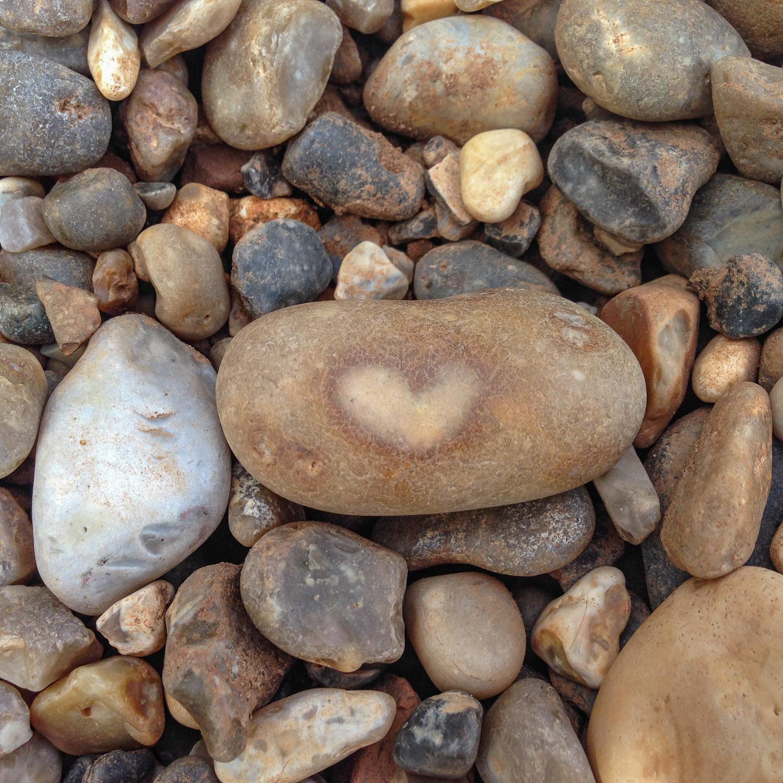 Orange pebble with a heart