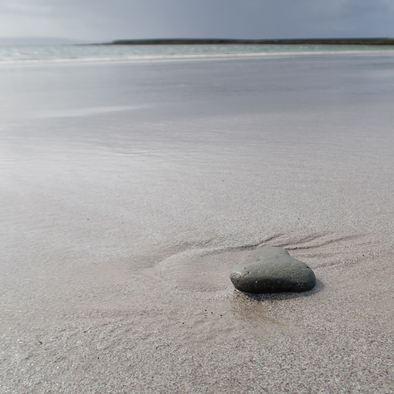 Heart shaped pebble on Bay of Tafts, Westray