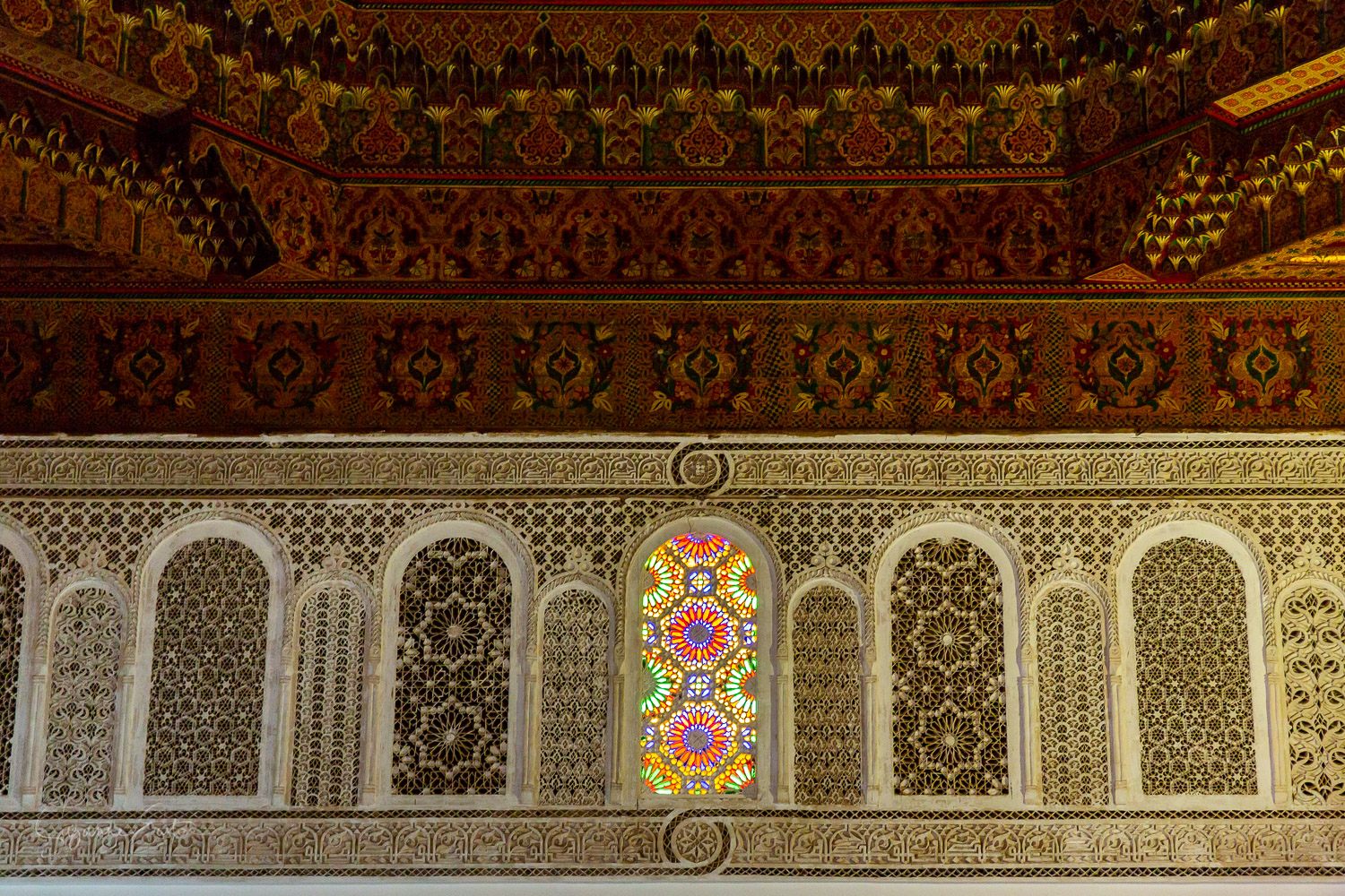 Stained glass and plasterwork carvings in Palais Bahia in Marrakech