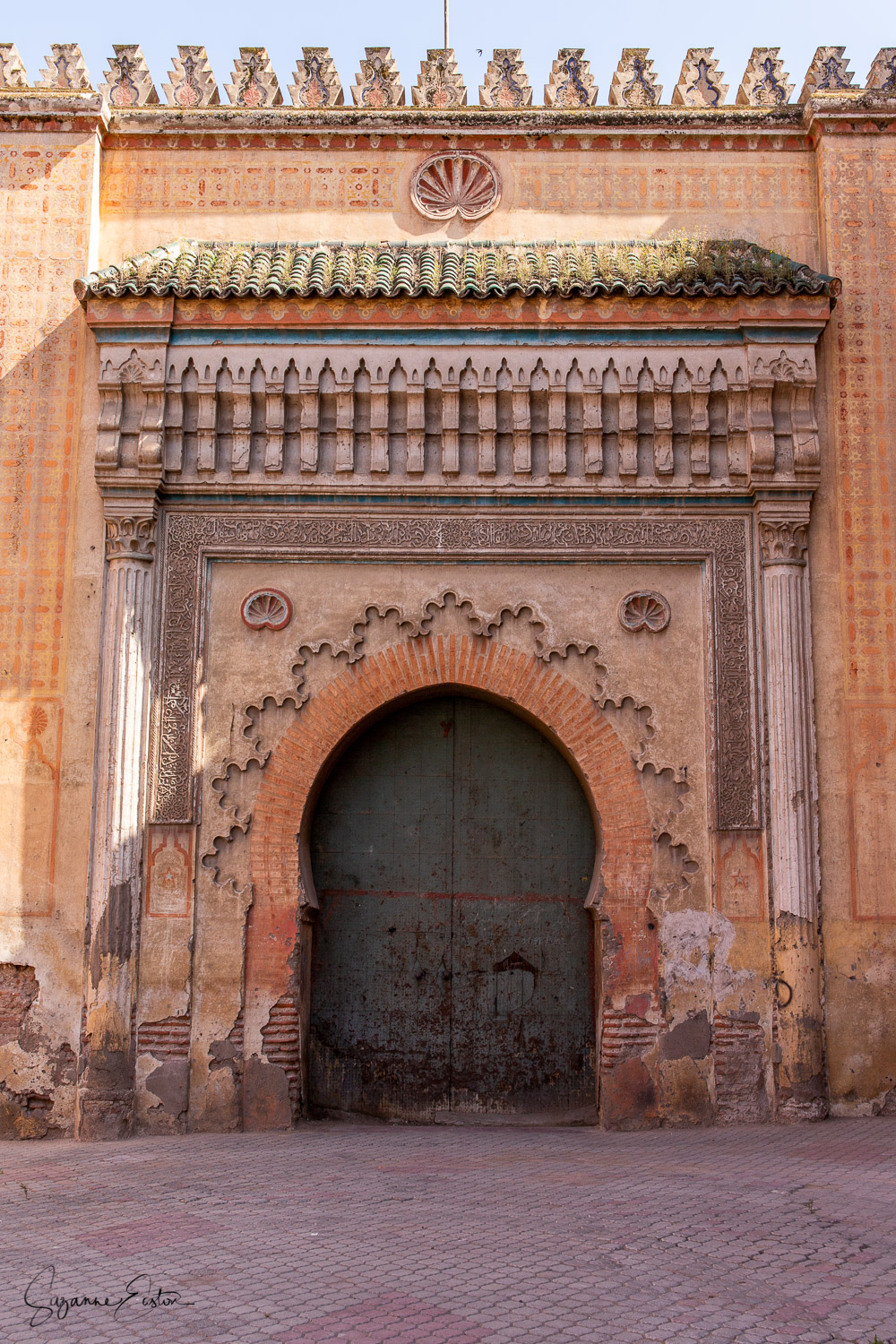 The ornate gateway to El Badi Palace in Marrakech