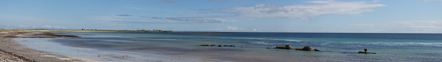 Panorama of Bay of Lopness on Sanday Orkney with shipwreck on shore