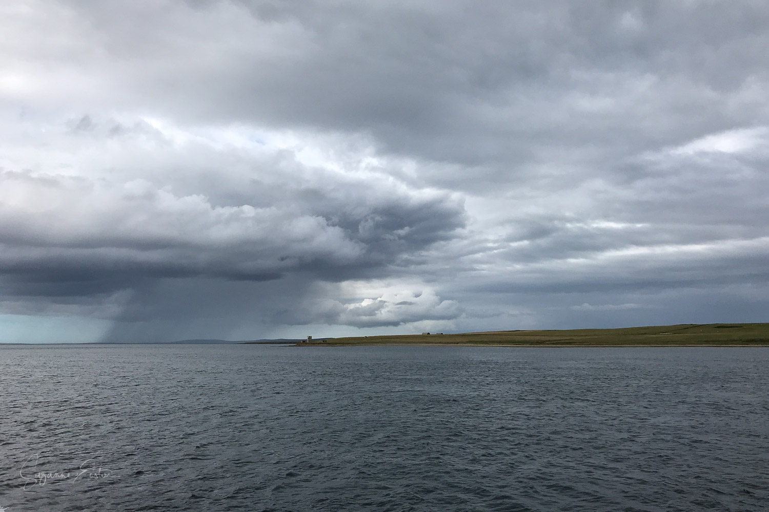Eday and Sanday in a rain shower from the ferry