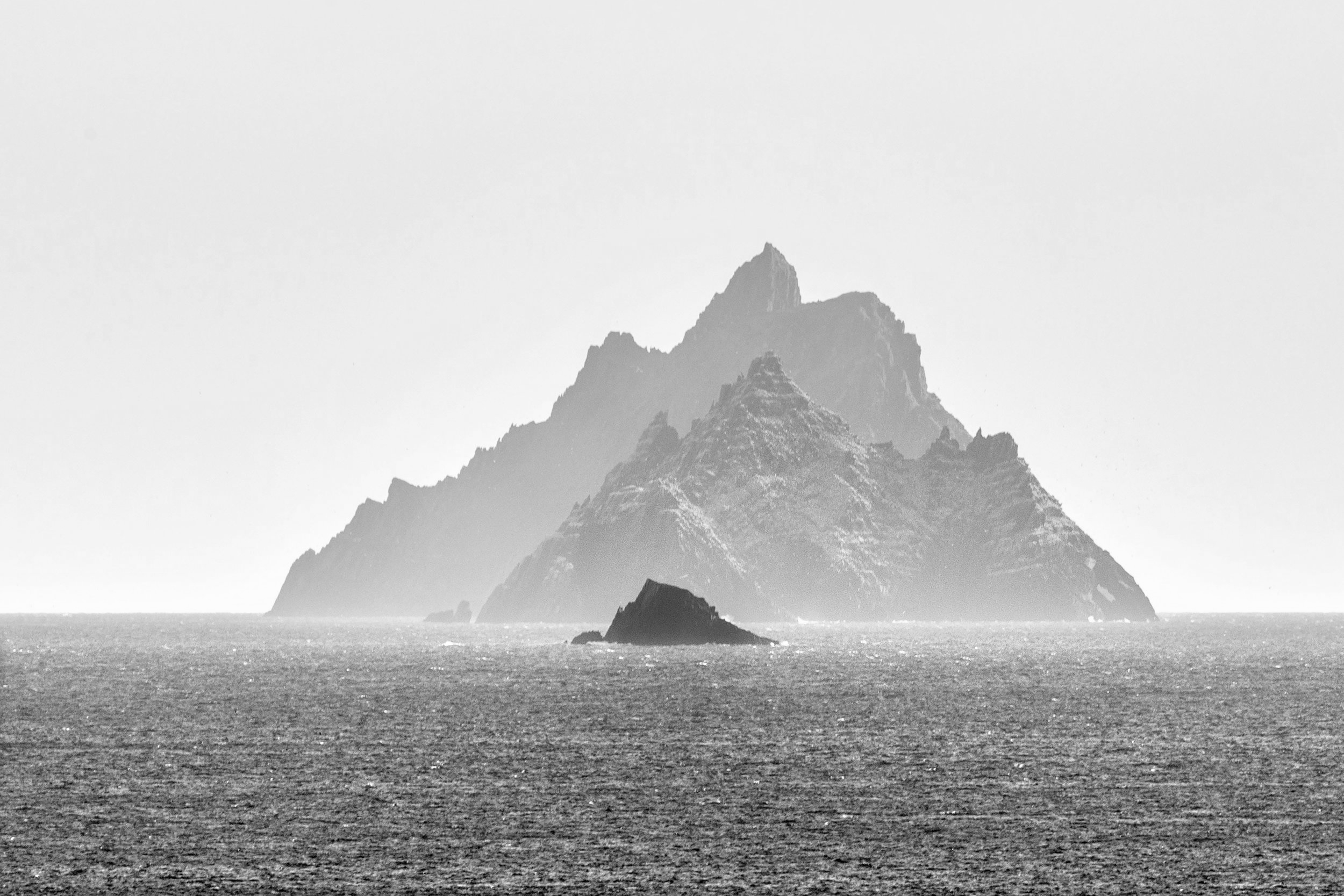 Skellig michael off the coast of Kerry in Ireland is a UNESCO World Heritage site and the location for Star Wars:The Force Awakens. Unsplash holding Image John Finn