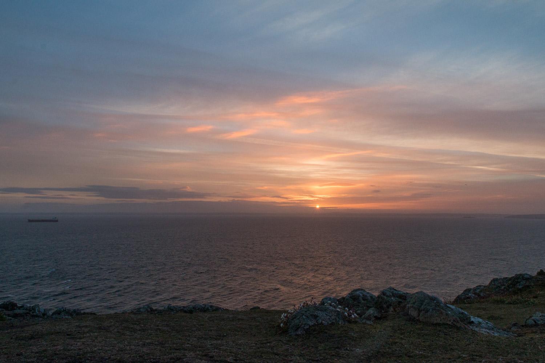 Solstice sunrise over the Garland stone on Skomer island