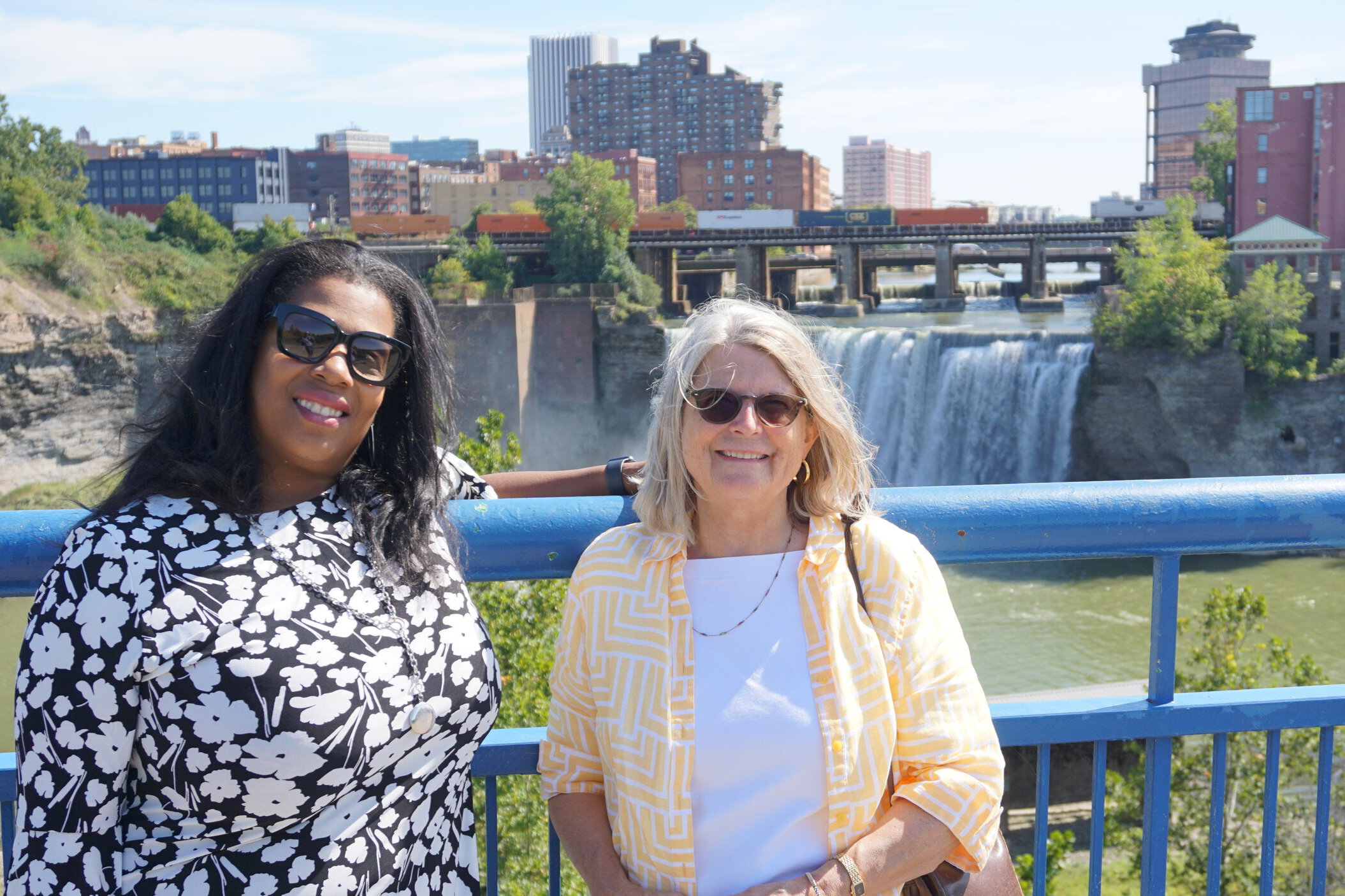 Rue Mapp and Gay Mills visit the Genesee River at High Falls.