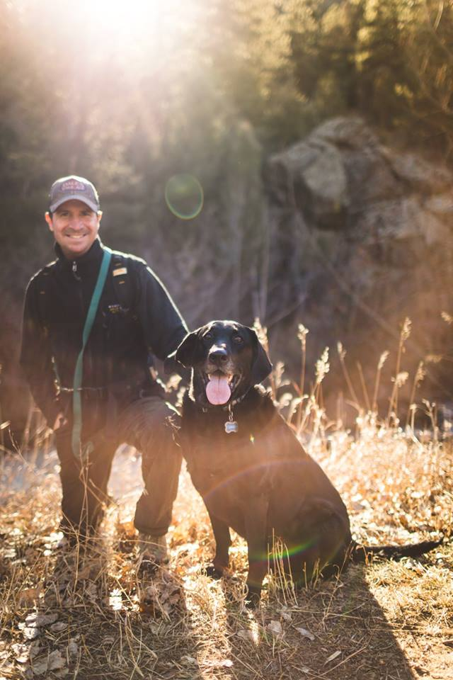 Our founder, Tim, enjoying the great outdoors with his adventure companion and inspiration, Ruger.