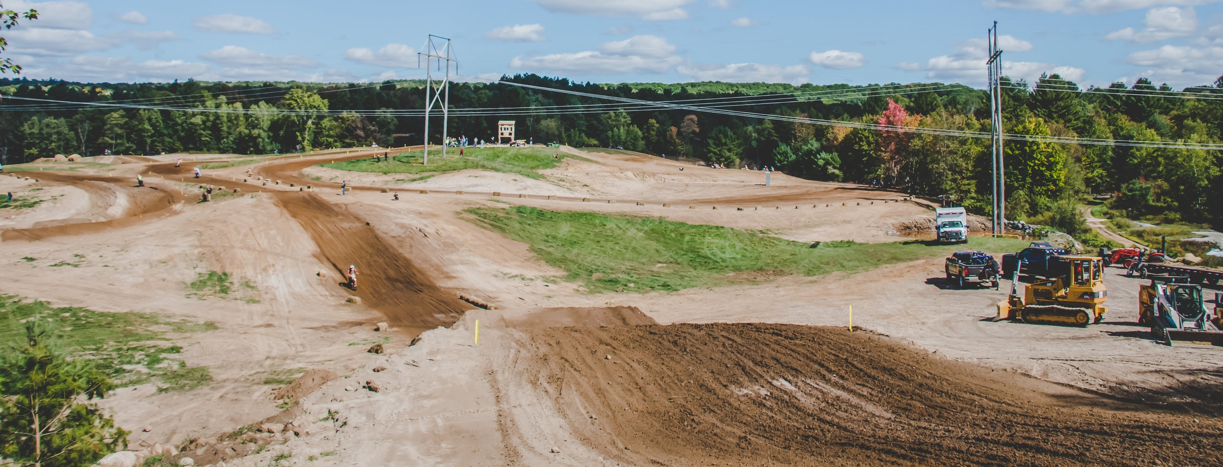 """High Voltage Hills is a family owned and operated track in the upstate New York region. We are located just south of the tug-hill plateau. We opened in the fall of 2016, with the 2017 season as our first racing season. We are part of AMA and C.N.Y.M.R.A District 3. Our track is making a name for itself due to the Loamy sand-soil conditions, high speed, and the natural flowing jumps and hills. There is plenty of parking in our """"pit"""" area, which is a 15 acre field. There are plenty of nearby lodges and hotels for rooms as well. We are located 5 miles from the town of brantingham, which has a few bars for food and some lodging as well. Being a new track we are trying our best to make racing and riding fun for everyone! We hope to see everyone at High Voltage Hills."""