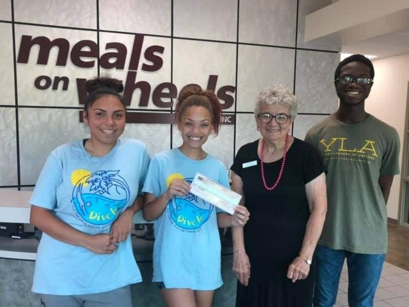 The YLA group chose to give the money raised to Meals on Wheels Plus, and a check for $396 was presented to Betty Bradley, Executive Director of MOW.