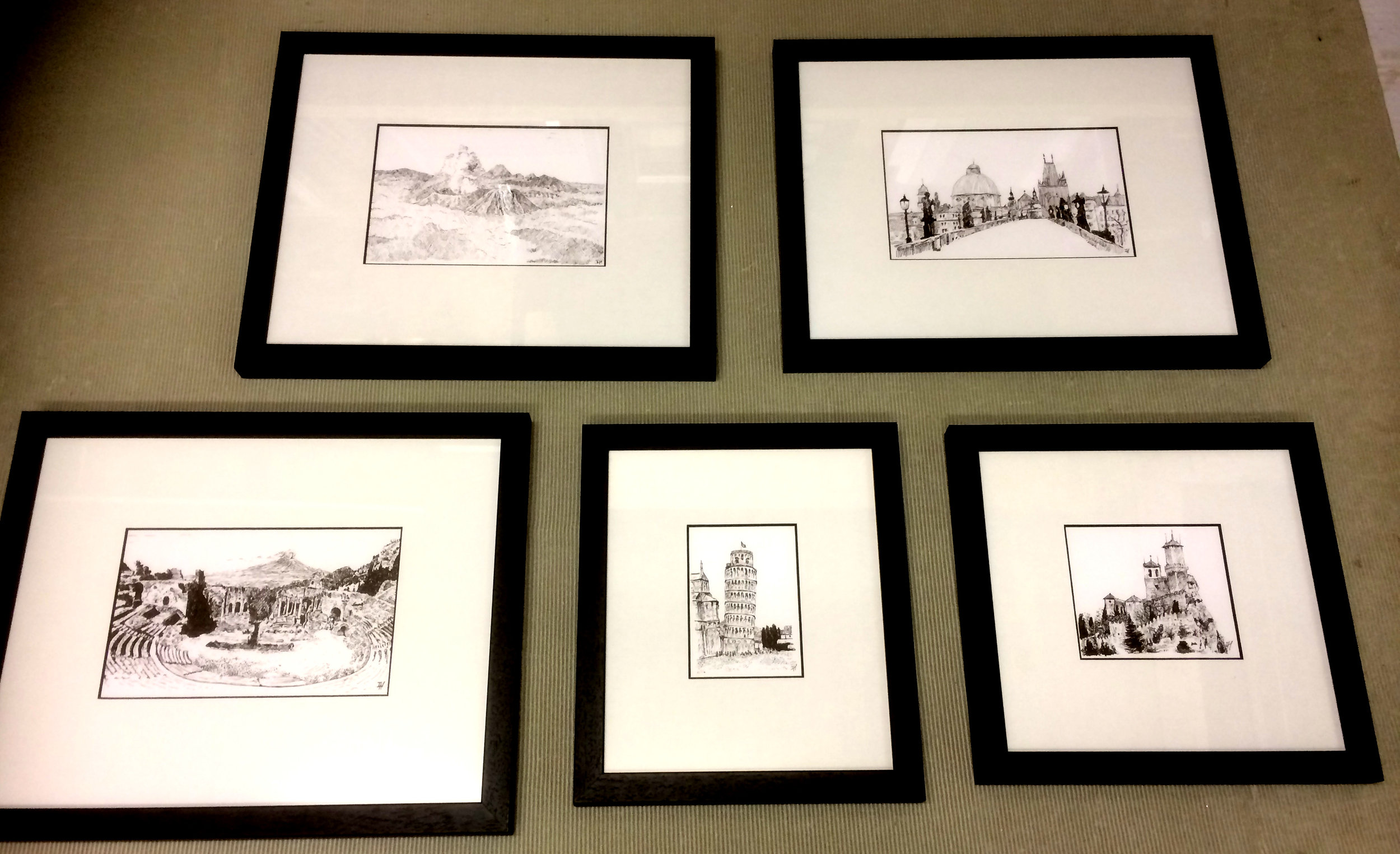 These original ink drawings were quite simply framed as our customer wanted. Single blackcore mount borders and a narrow black frame. Conservation backing board and tape was used.