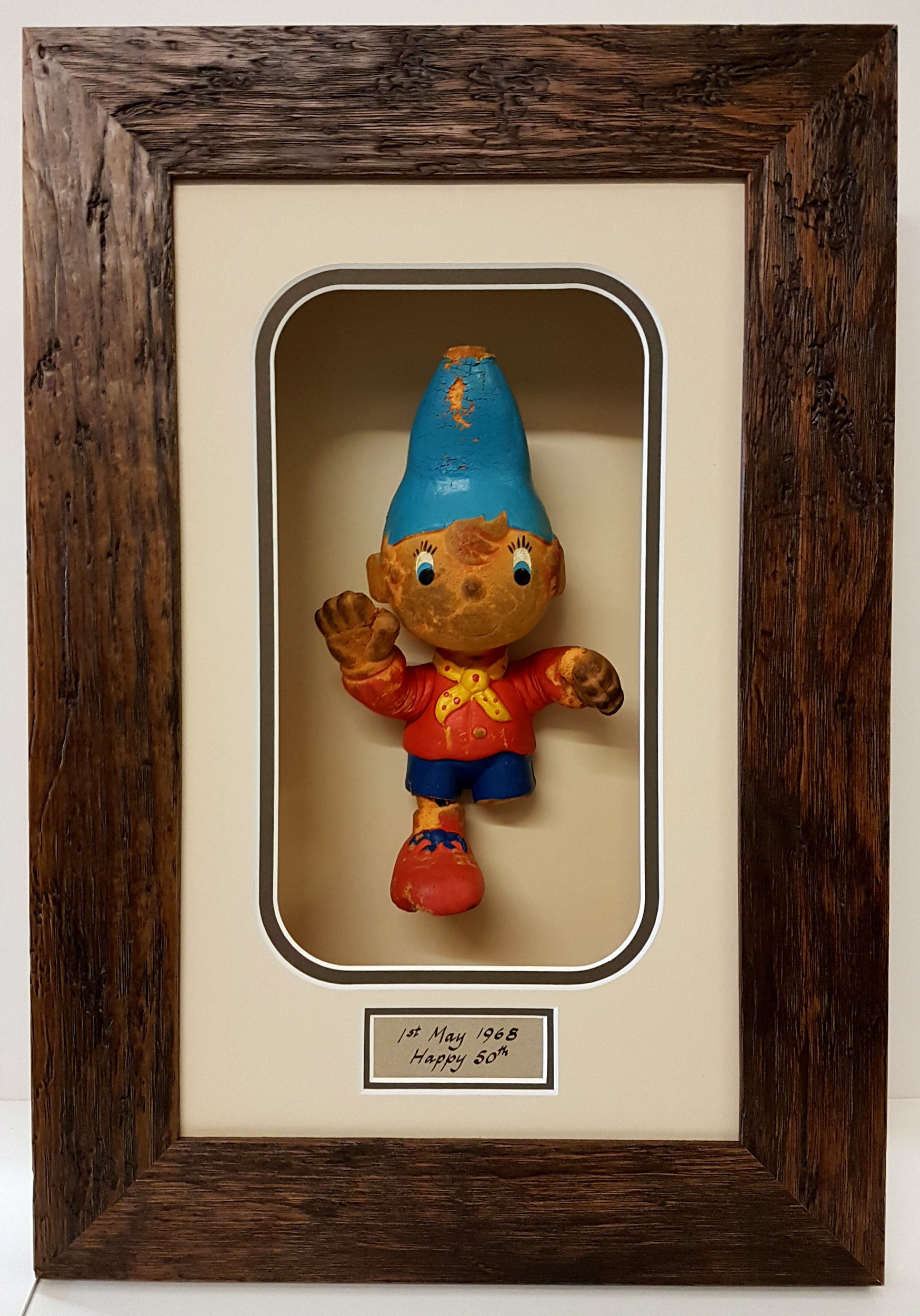 This 1960's Noddy toy was very delicate, even to handle. I had to fix a leg back on then suspend the toy in place without showing any sign of how it was done. A box frame was needed and I hand wrote the sub-text for a touch of vintage authenticity. Invisible glass is perfect for this type of framing.
