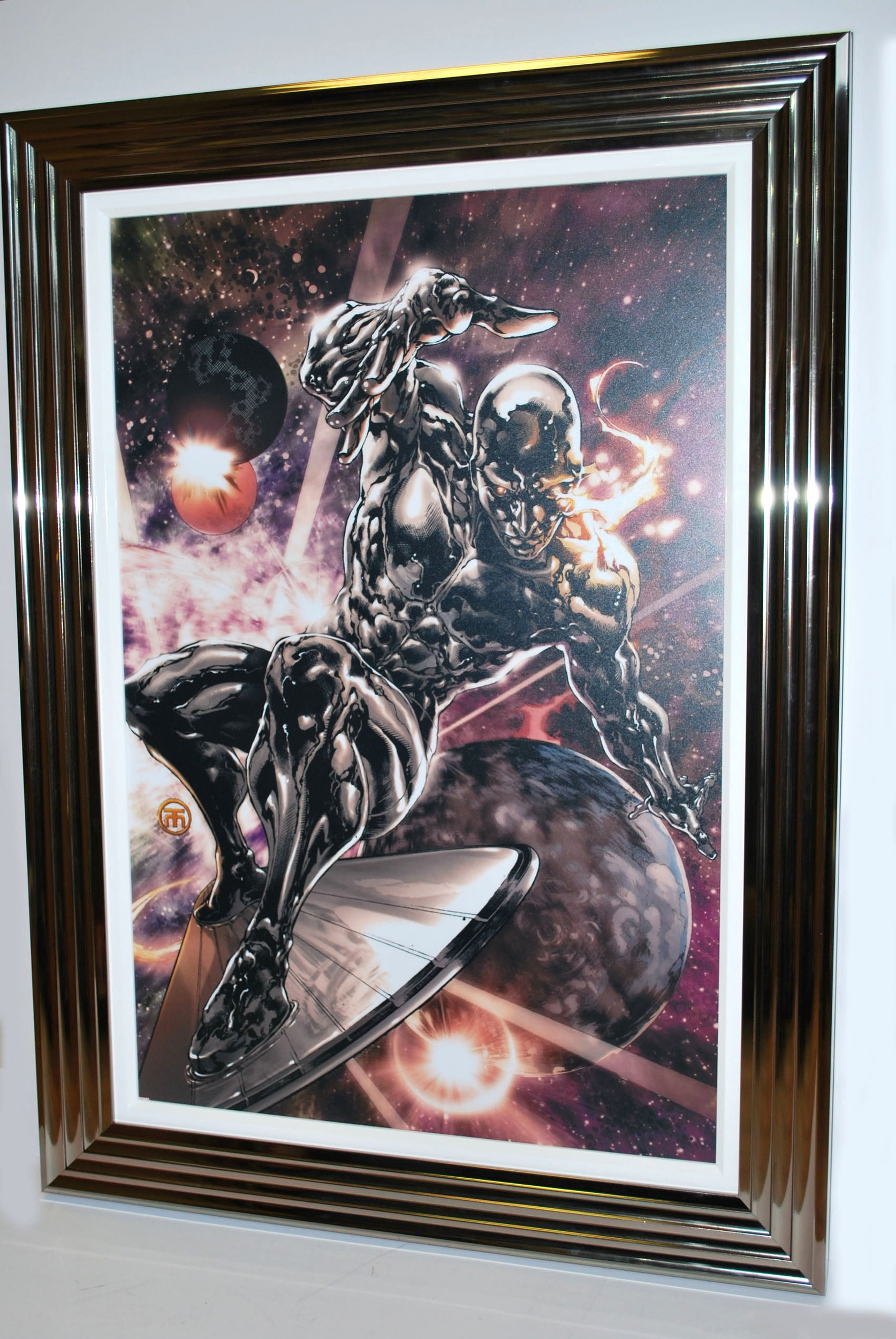 A laminated poster from Marvel. This Silver Surfer print was panel bonded and framed in a spectacular fashion to make a real impact