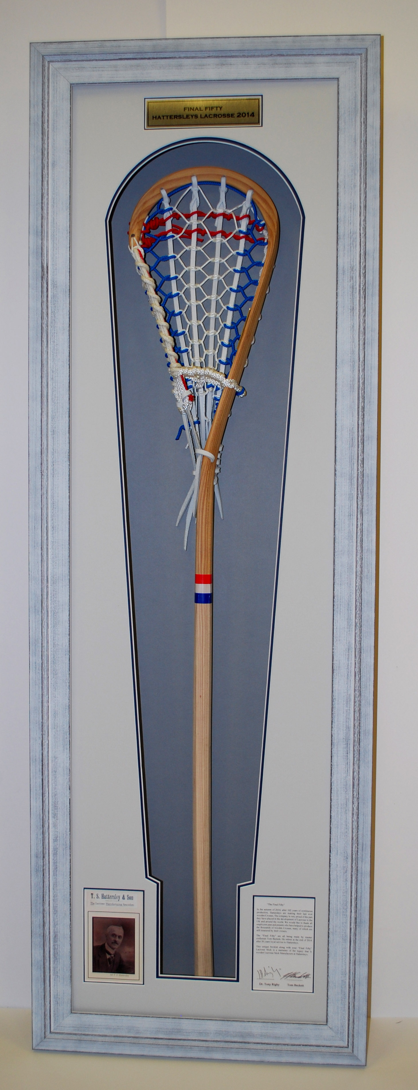 A historical lacrosse bat beautifully framed and preserved held into place with hidden fixings.