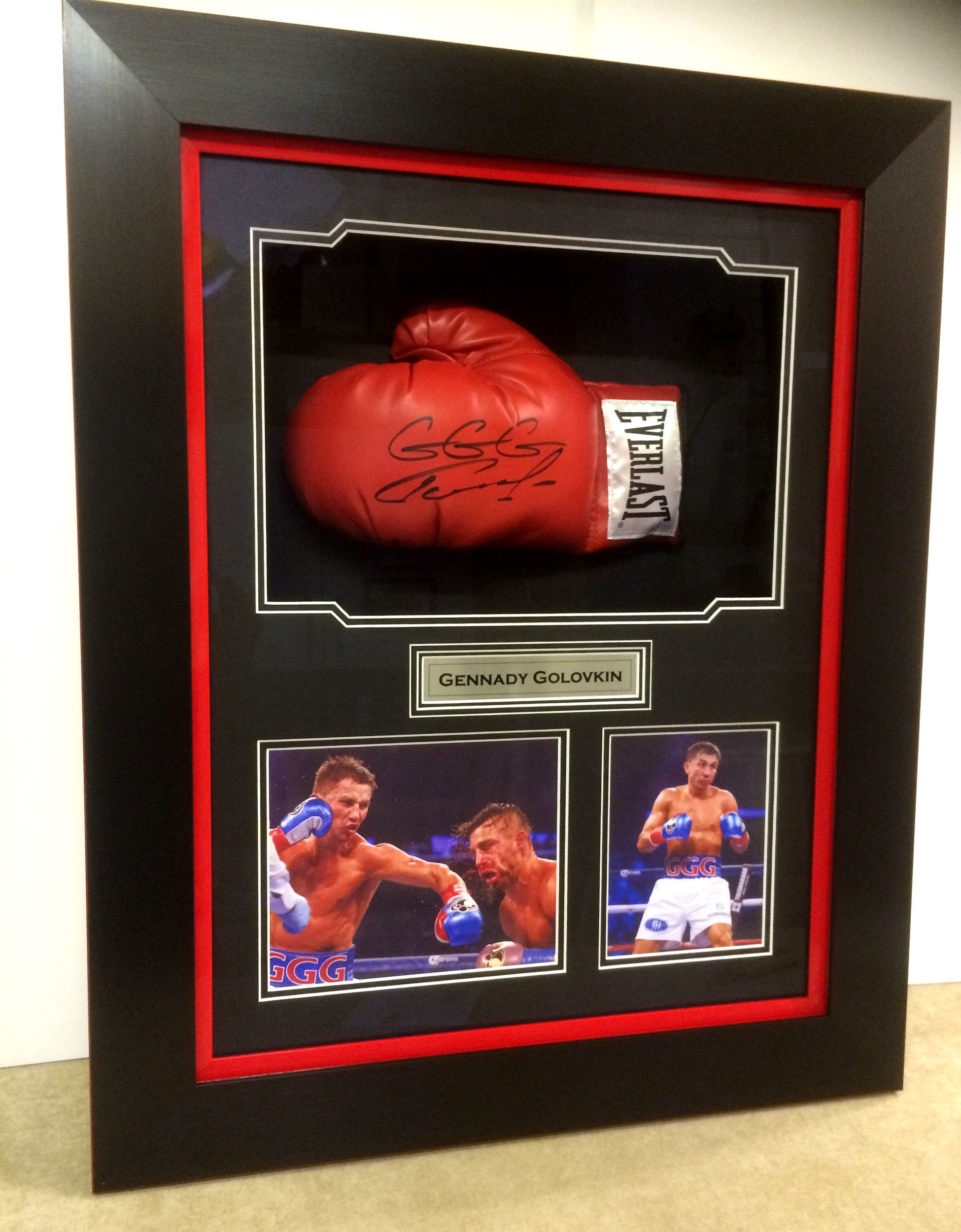 The boxing glove are held by hidden anchors and the box frame is lined with the same backing colour to make the glove stand out in its own chamber. A sublimation plaque is placed in a central position to finish it off. UV filter glass stops any colour fading to preserve the items.