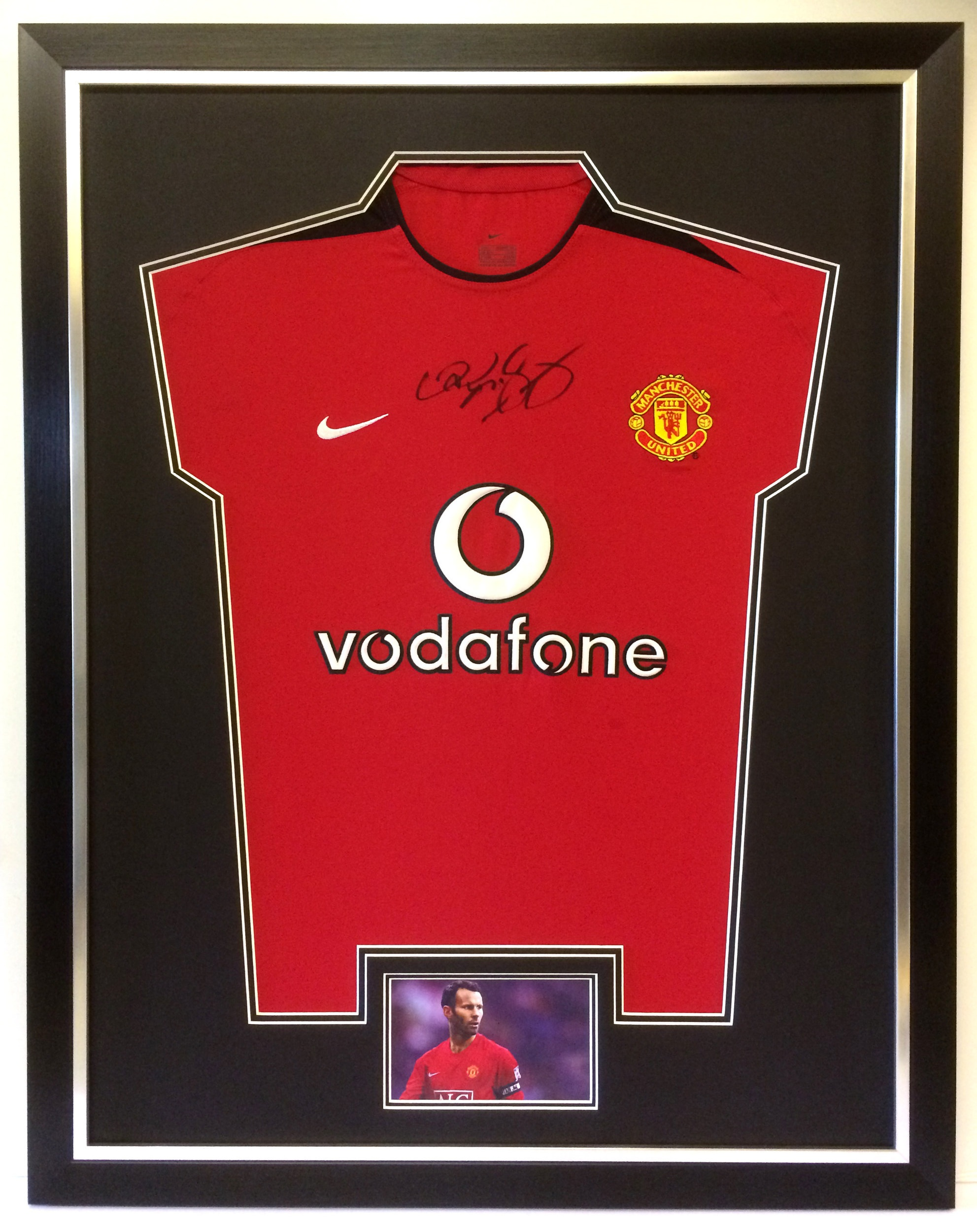 Our customers'  most popular choice for framing shirts. We have one on display in the gallery. We do not use sticky tape but pin them in place and level the backs to give a neat finish on the reverse. A deep frame is needed to stop any bowing on the back.