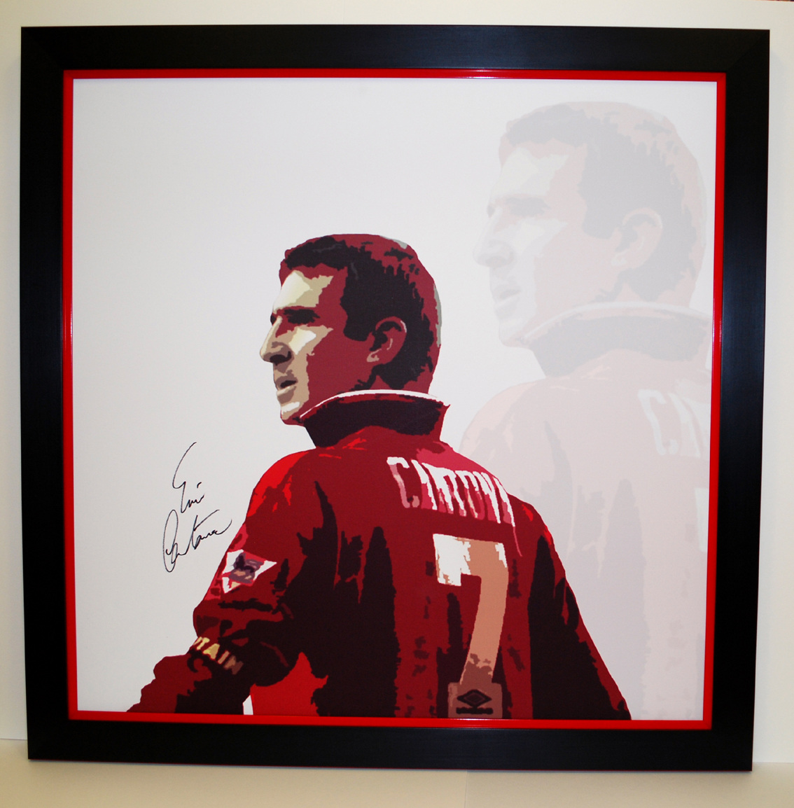 A large Eric Cantona personally signed canvas which we stretched and framed. We actually sell these in our gallery.