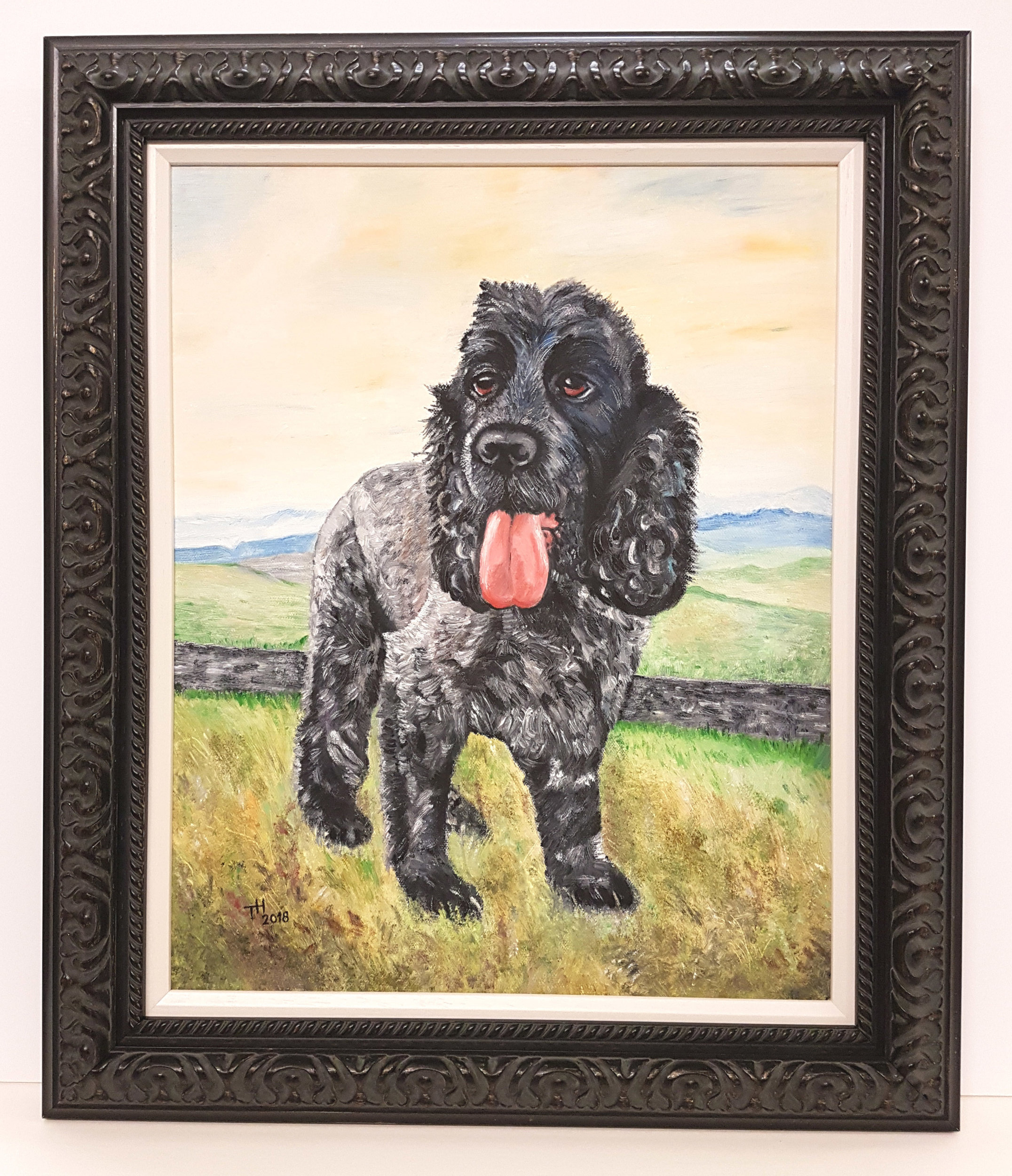 An oil painting done from a photograph and framed in an ornate charcoal frame with an inner slip that seperates the moulding from the canvas
