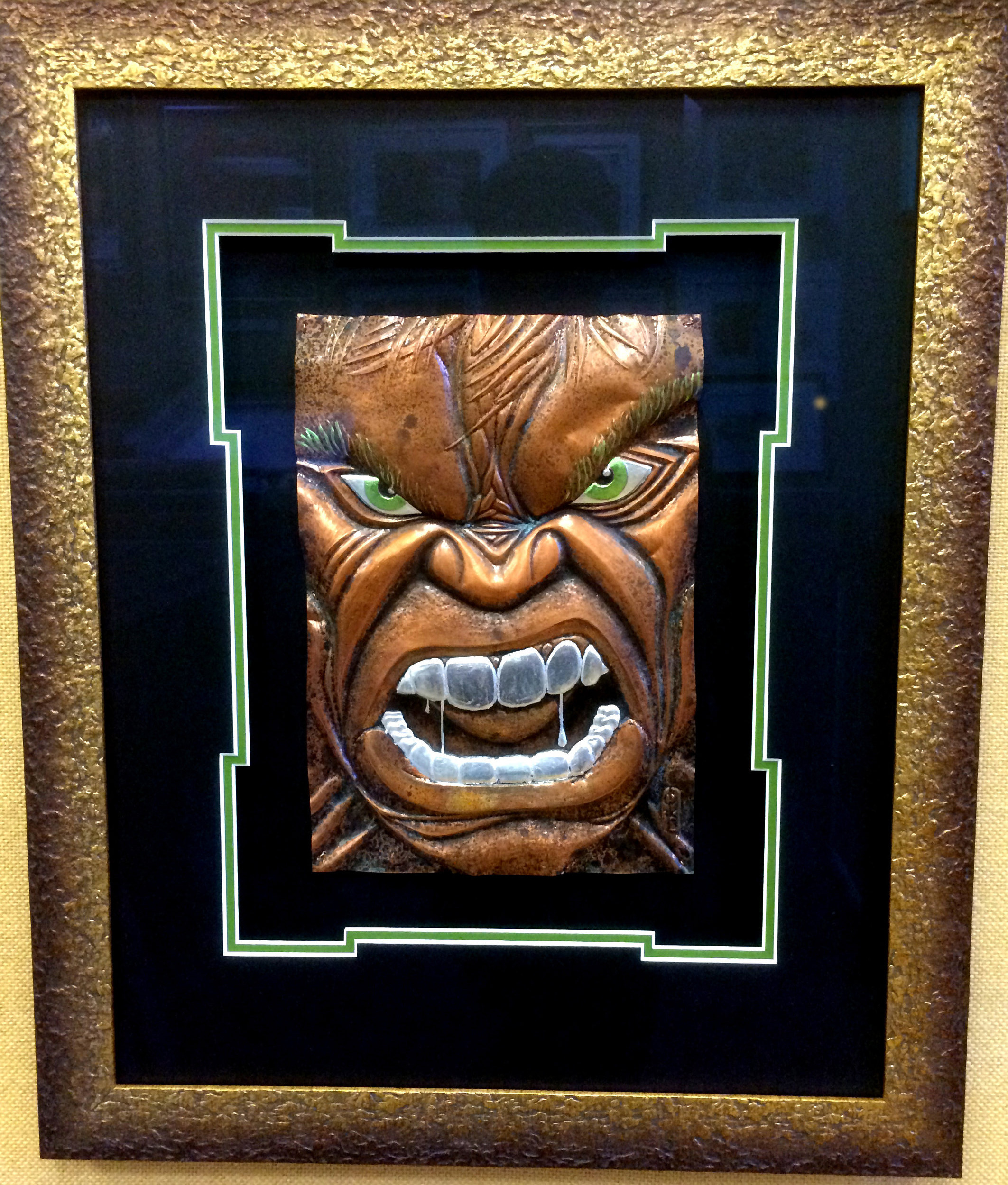 This Hulk original was created by local artist Chris Duncan using copper sheeting and patinating substances. Invisible glass makes the image seem like it is ready to burst out from the frame