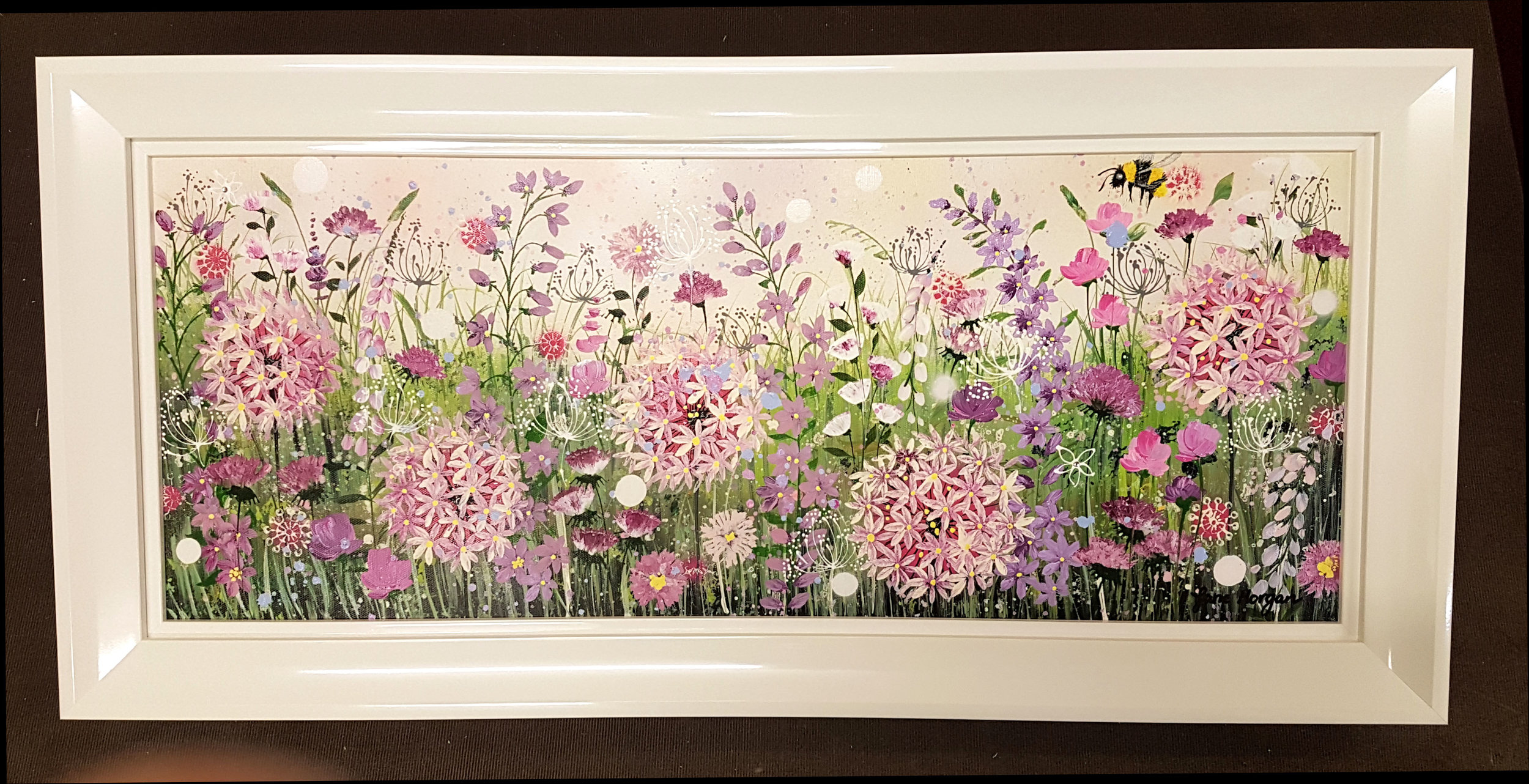 A stretched canvas by artist Jane Morgan framed in a large white high gloss frame with an inner gloss laquered slip moulding for added depth.