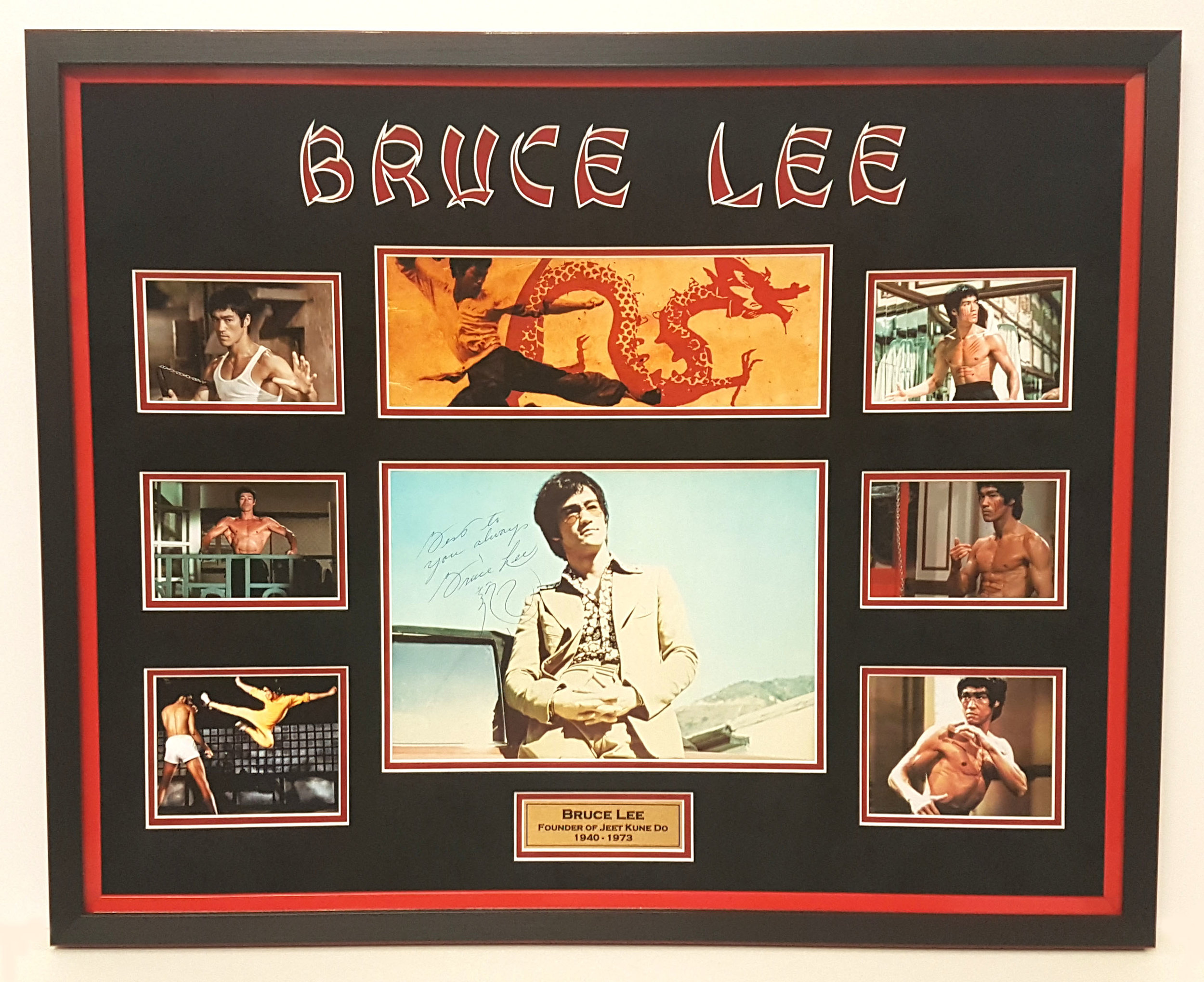 A Bruce Lee signed poster and a collection of photos framed in suedette mount borders with carved out title lettering done on our Gunnar CMC machine. This is a good example of top level conservation framing as the item was of very high value. The client left it to me to choose the frame and layout. Love it !