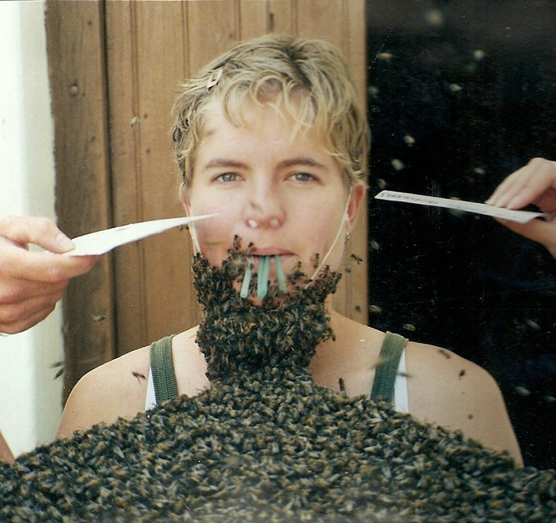 Paraguay, 2000 - getting my introduction to the bees in Peace Corps training. There's a queen in a cage strapped to my chin. The rest of the bees just want to be with her. Hands are keeping bees from taking a tour of my eyeballs.