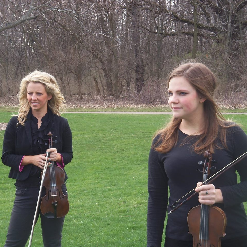 The Sisters - The Hatfield Sisters, as a musical group, was formed inadvertently by sisters, Anne and Mary Hatfield, after many years of playing together at home.Although classically trained, the Sisters musical repertoire thrives on a fusion of Irish, Scottish and Cape Breton Fiddle music. Steeped in tradition, these Celtic fiddle styles retain their musical relevance with the Sisters subtle variations and fresh arrangements. The Hatfield Sisters musical escapades have taken around the world with both girls having the opportunity to tour with Michael Flatley's Lord of the Dance. The girls combine have traveled and performed in 3 continents, 48 of the United States and in over 30 countries.They have had the opportunity to share the stage at numerous venues including Milwaukee Irish Fest, Chicago Celtic Fest, Chicago Cultural Center, Northern Illinois, The Rialto Square Theatre, Chicago's Navy Pier, and Manhattan Irish Fest.Their combination of high-energy step-dance and fiddling creates a contagious exuberance, infecting audiences with irrepressible clapping and toe-tapping.
