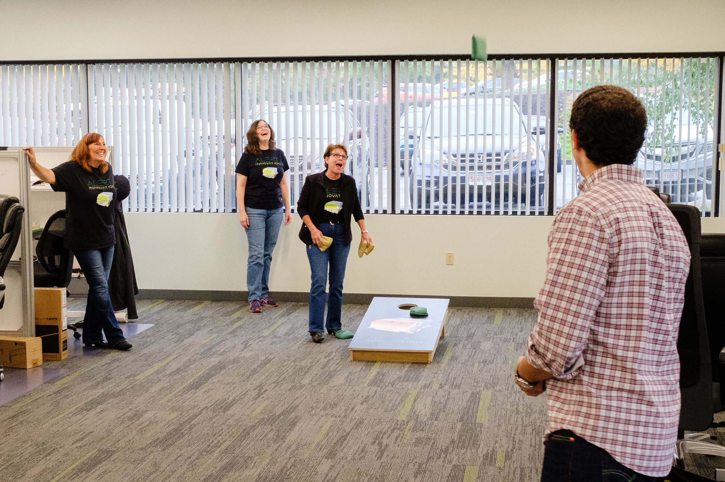 Copy of Copy of Employees of Alert Innovation taking a breather and playing cornhole. Photo taken October 2018