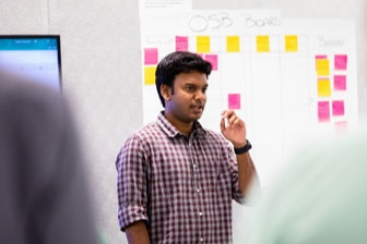 Copy of Copy of Copy of An engineer leading a team meeting at Alert Innovation. Headquartered in North Billerica, Alert is a robotics, machine learning, and artificial intelligence startup.