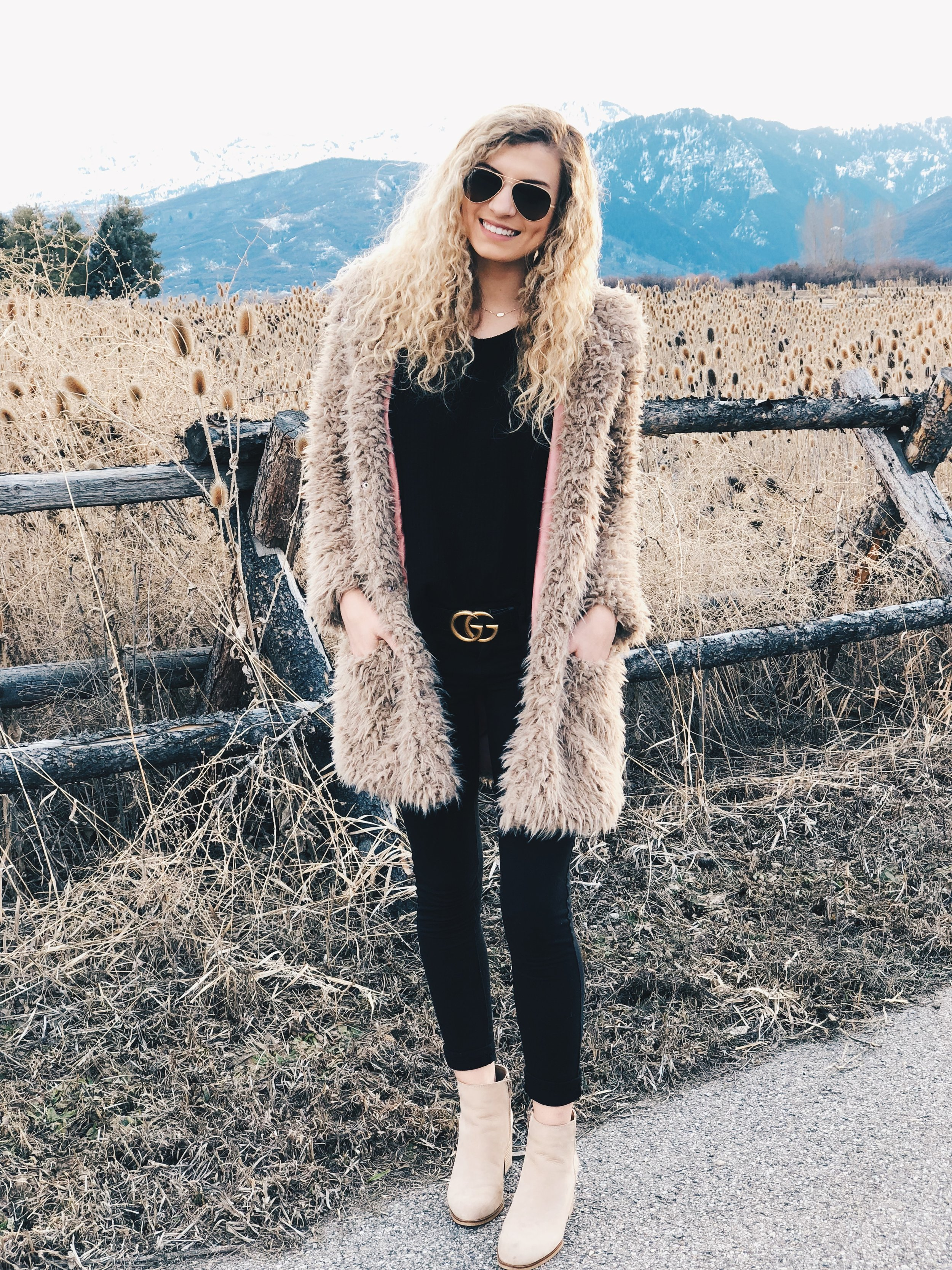 Booties:  These booties are available for $62.50 and you can shop them by clicking  HERE    Belt:  This belt is from Gucci and you can shop it by clicking  HERE    Coat:  This fur coat is on sale for $37.00 and you can shop it by clicking  HERE
